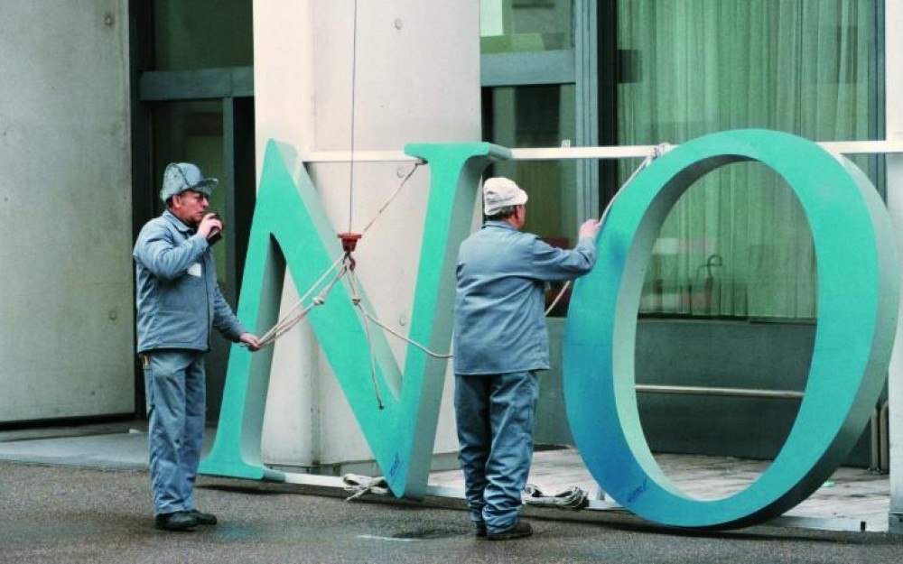 Old Novartis logo being changed out at the Novartis St. Johann site in Basel